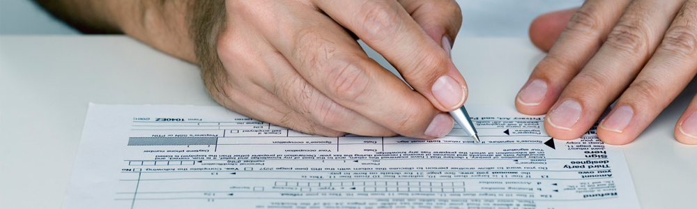 Financial support image of hands filling out a form