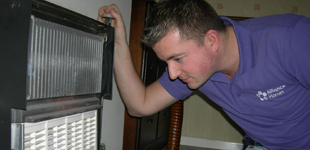 A repairs operative looks at a fireplace