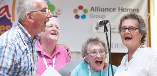 4 older people singing at the Festival of Ages