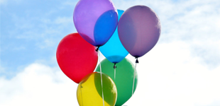 Alliance Homes Group brand coloured balloons