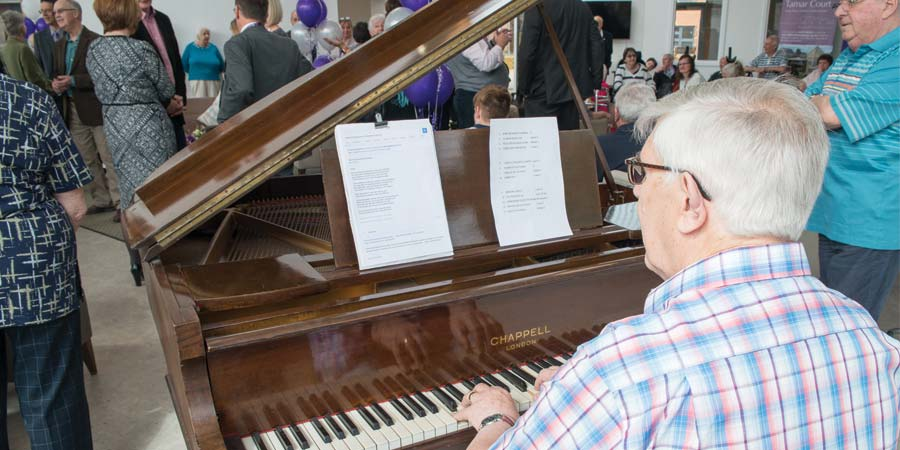 John a resident at Tamar Court plays the piano